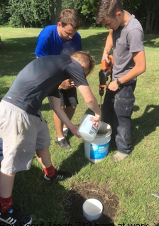 Boy Scout Troop 732 hard at work mixing / pouring concrete for surveyed control point.